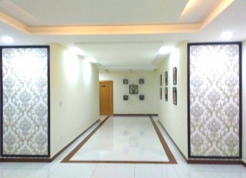 The lobby or reception area at Hotel Civic - Gujranwala