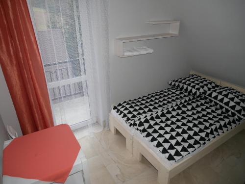 Łóżko lub łóżka w pokoju w obiekcie Dom Weselny Bartpol Family&SPA