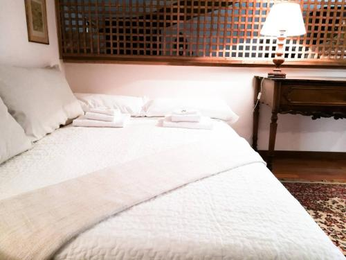 A bed or beds in a room at Navona Penthouse Accommodation