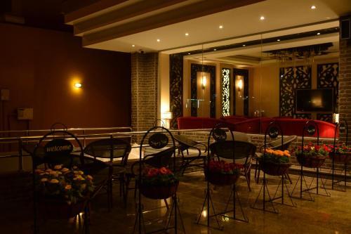 مطعم أو مكان آخر لتناول الطعام في هوم ان للاجنحة الفندقية