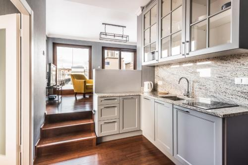 Kuchnia lub aneks kuchenny w obiekcie Triton Park Apartments