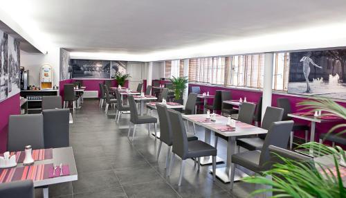 Restaurant ou autre lieu de restauration dans l'établissement Privilège Hôtel & Apparts Eurociel Centre Comédie