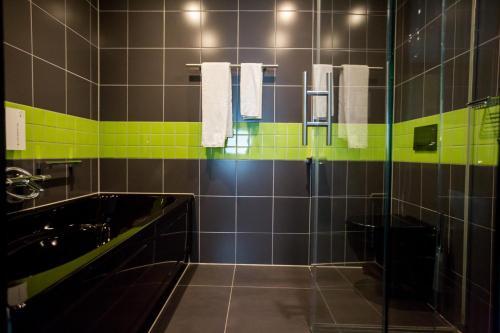 Ein Badezimmer in der Unterkunft Tulip Inn Eindhoven Airport