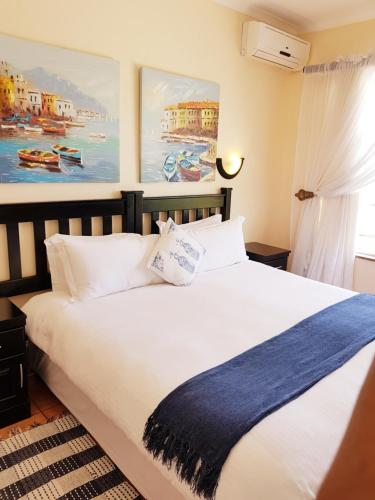 A bed or beds in a room at Tariman Boutique Hotel