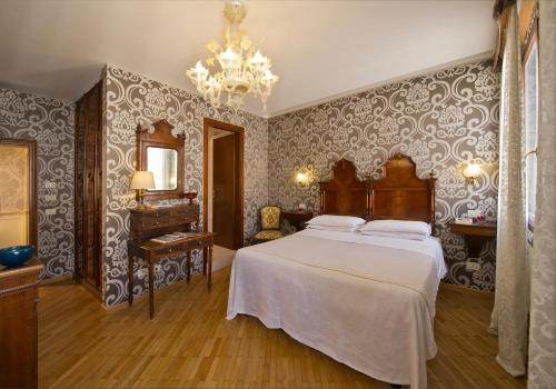 Ein Bett oder Betten in einem Zimmer der Unterkunft Hotel Casa Nicolò Priuli