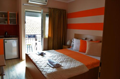 A bed or beds in a room at Apartments LAVO