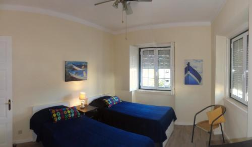 A bed or beds in a room at Apartment Downtown Faro