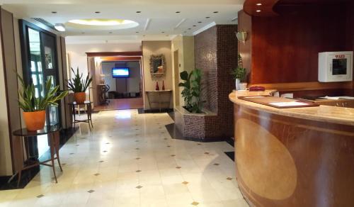 The lobby or reception area at Castelli Hotel Nicosia