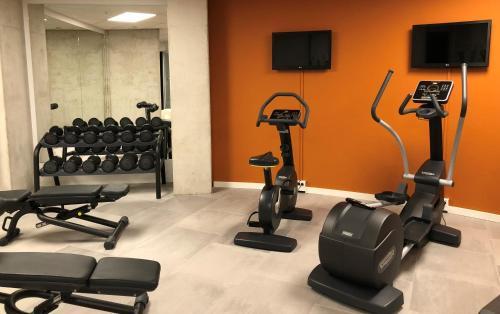 Het fitnesscentrum en/of fitnessfaciliteiten van Room Mate Aitana