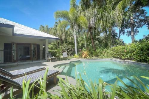The swimming pool at or near Tranquility By The Course Port Douglas