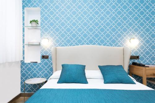 Un ou plusieurs lits dans un hébergement de l'établissement Hostal Oriente
