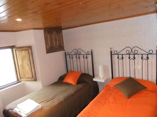 A bed or beds in a room at Casa Saleta
