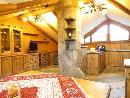 Kuchyň nebo kuchyňský kout v ubytování Apartments & Rooms MyHolidayLivigno