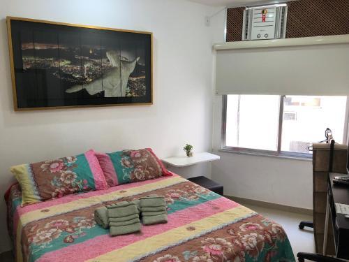 Cama ou camas em um quarto em Apartamento Nossa Senhora Posto 4
