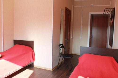 Кровать или кровати в номере Гостиница Иркут