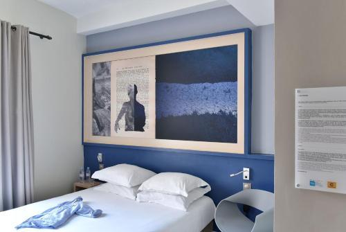 Un ou plusieurs lits dans un hébergement de l'établissement Hotel Spa Le Calendal