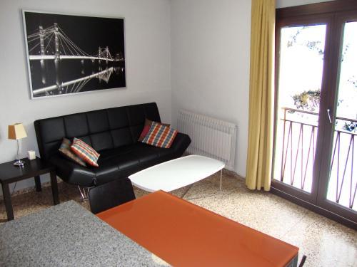 A seating area at Apartamentos Arinsal 3000