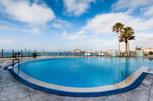 The swimming pool at or near Kn Hotel Arenas del Mar Adults Only
