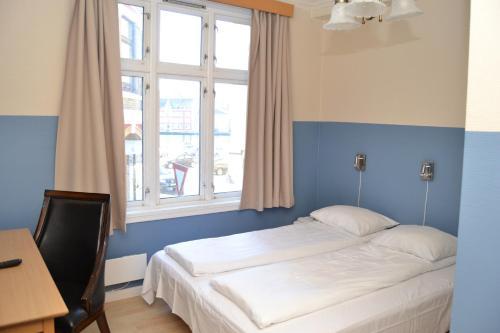 スカンセン ホテルにあるベッド