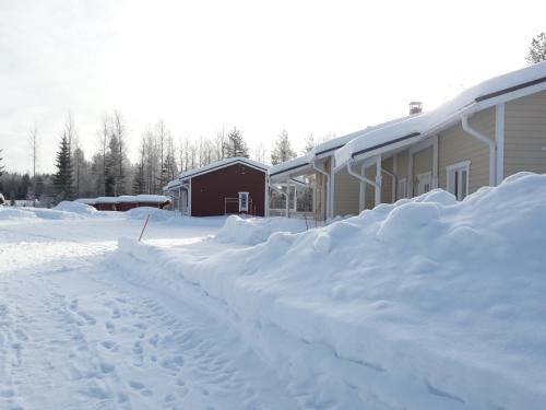Ristijärven Pirtti Cottage Village during the winter