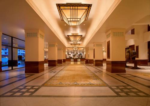 The lobby or reception area at Hyatt Regency Kinabalu