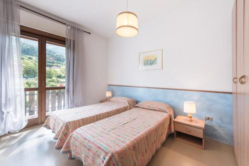 A bed or beds in a room at Albergo Cinzia