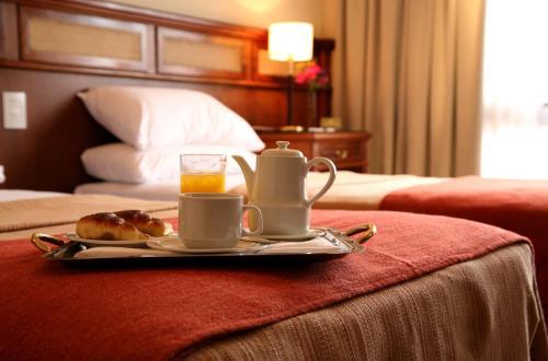 Cama ou camas em um quarto em Ayres De Salta Hotel