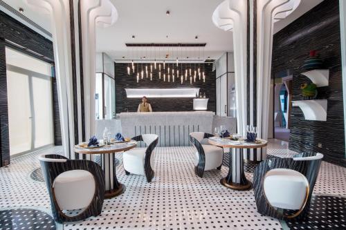 مطعم أو مكان آخر لتناول الطعام في Reef Boutique Hotel