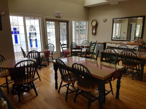A restaurant or other place to eat at Lady MacDonald Country Inn