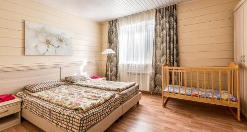 Кровать или кровати в номере Эко-Отель Маяк