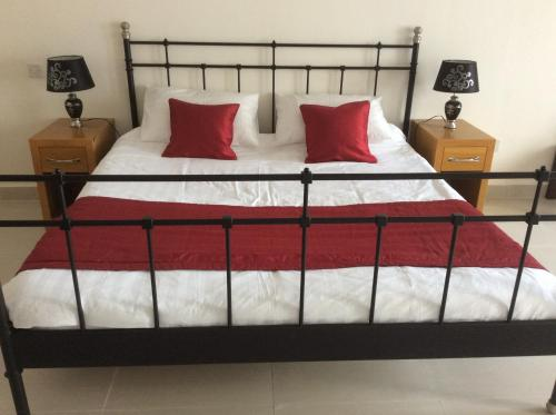 A bed or beds in a room at Swiss Boutique Hotel