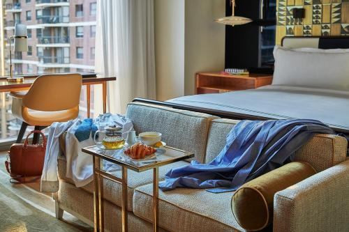 A bed or beds in a room at Viceroy Chicago