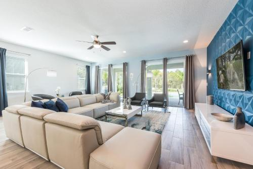 A seating area at Striking Home with Loft Area & Games near Disney - 7728F