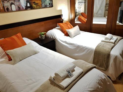 Cama o camas de una habitación en Aqua Rooms Sarria