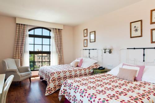 Кровать или кровати в номере PortAventura® Hotel Gold River - Includes PortAventura Park Tickets