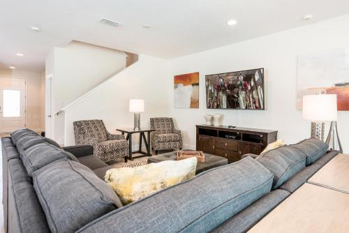 A seating area at Fantastic Home with Media Room & Games near Disney - 7718F