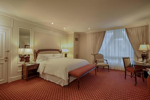 A bed or beds in a room at The Westin Camino Real, Guatemala