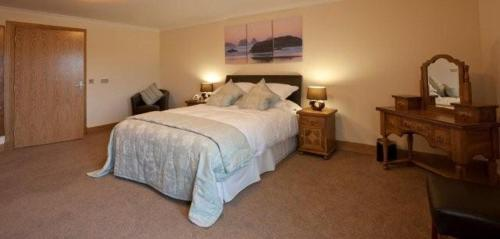 A bed or beds in a room at Borve House Hotel