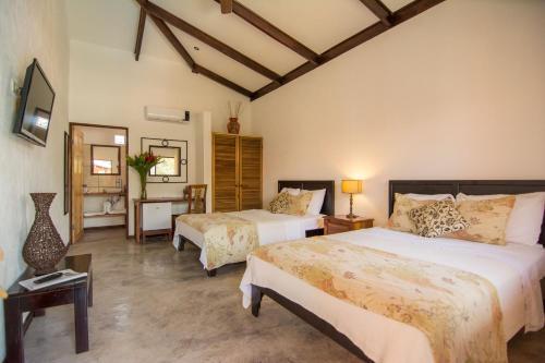 Cama o camas de una habitación en Conchal Hotel