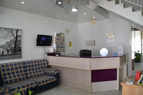 The lobby or reception area at Hotel Congra