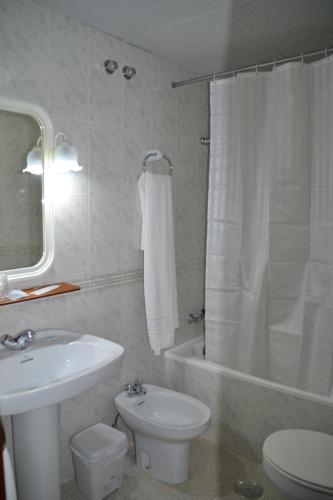 A bathroom at Hotel Congra