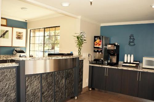 A kitchen or kitchenette at Executive Inn