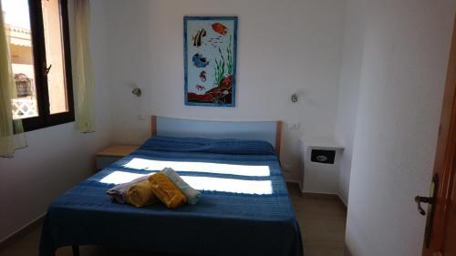 Letto o letti in una camera di Appartamenti Agrustos