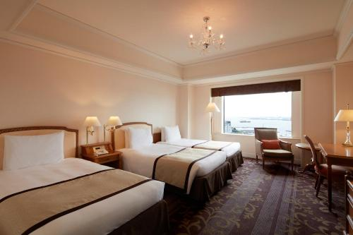 A bed or beds in a room at Grand Nikko Tokyo Daiba