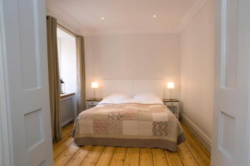 A bed or beds in a room at Residence Perseus
