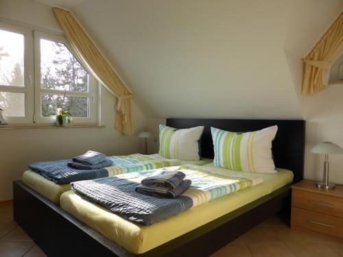 Ein Bett oder Betten in einem Zimmer der Unterkunft Villa Charlot