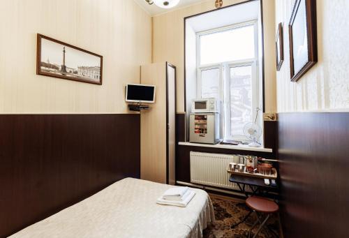 Телевизор и/или развлекательный центр в Мини-Отель Дом Романовых