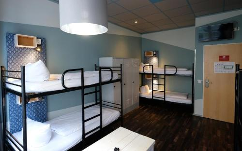 A bunk bed or bunk beds in a room at Singer109 Hotel & Apartment