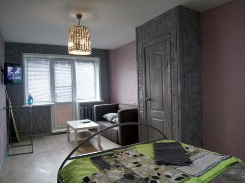 Гостиная зона в Apartment on Nikolaya Budy