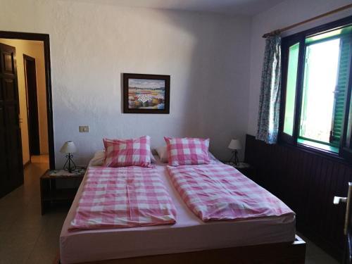 Un ou plusieurs lits dans un hébergement de l'établissement Apartments Finca El Rincón